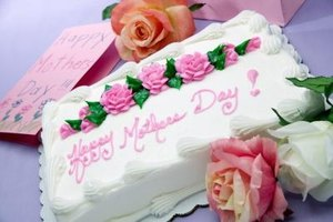 Roses made from frosting are a traditional decoration for cakes.