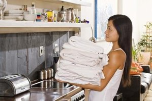 A laundry table can free up your hands when separating the white clothes from colored cloths.