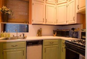 Paint wood kitchen cabinets all the same color for a harmonious look.