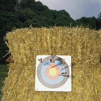 An inexpensive archery target butt made from hay bales.