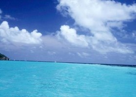 Teal is a color that is frequently used to describe the color of the ocean on Caribbean beaches.