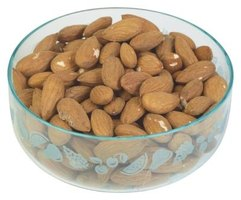The brown skin of almonds holds fast to the nut and removing it will take more than one step.