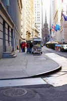 Street vendor carts have to stay within 18 inches of the curb in New York City to not obstruct the sidewalk traffic.