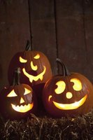 Forgo the traditional Jack-O-Lantern look and create themed pumpkins.