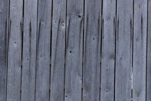 An aged wood fence shows natural fading.