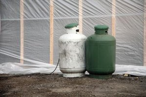 You can paint polyethylene tanks with acrylic house paint.