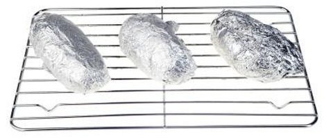 Coat potatoes in salt and wrap them in aluminum foil before baking.