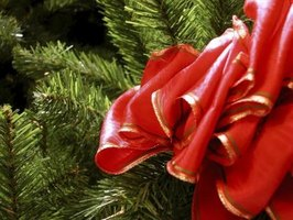 Weave a ribbon through a wreath to enhance a holiday theme.