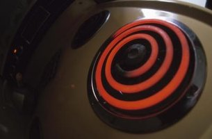 An electric stove's burner element heats up your food via coils.