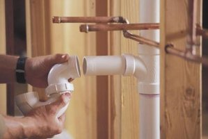 PVC pipes expand when hot water runs through them and they can make some odd noises as a result.