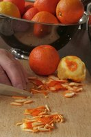 Slice citrus peels into small strips to make marmalade.