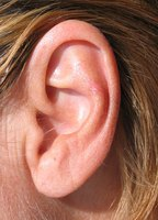 Fake an earring on an unpierced ear with a captive bead ring.