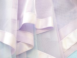 Tulle has a gauzy appearance like mosquito net, but comes in a wide variety of colors.