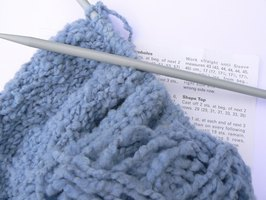Knit a hat for a cancer patient.