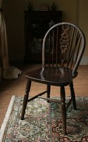 Consider using traditional textiles to upholster your Windsor chairs for an authentic feel.