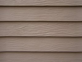 Fill the cracks in HardiPlank siding with silicone caulk.