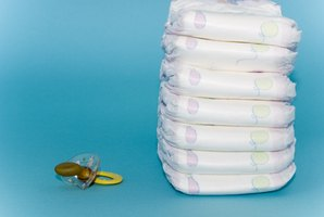 Give party guests diapers to decorate as a humorous baby shower activity.