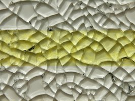 Tempered glass is intentionally shattered in a systematic way for use in mosaic art.