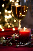 Use candles to create lighting and mood at your Christmas dinner table.