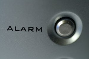 Wired alarm systems can contain wireless security devices to strengthen household defenses.