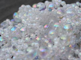 Clear or irridescent glass beads represent air bubbles in your dollhouse aquarium.