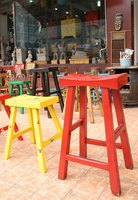 Dress up wooden stools with a fresh coat of paint.