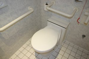 Grab bars make this handicapped accessible bathroom usable and safe.