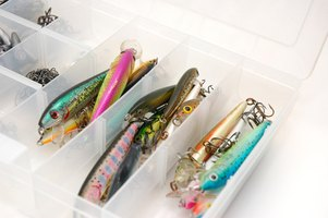 Plastic storage container with a variety of fishing lures.
