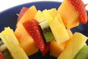 Fruit on skewers with yogurt dip gives guests something to nibble on as they circulate.