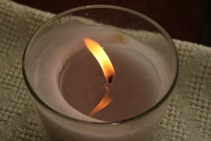 Cleaning wax from glass jars and candleholders requires heat