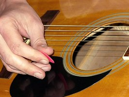 Write a catchy melody on your guitar.