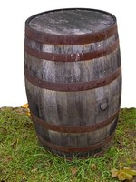 Used half whiskey barrels make great moveable ponds which can be arranged around gardens.