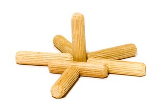 Dowels can be made of many materials, including wood for woodworking projects.
