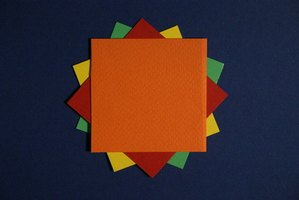 Colored craft paper can be used to make cool paper cuts.