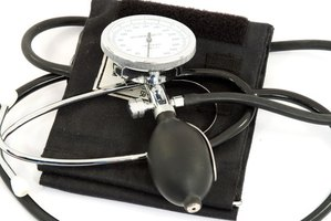 Patient care associates check vital signs such as blood pressure.