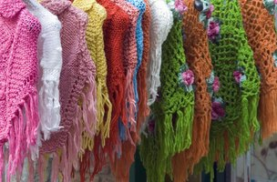 Knitted ponchos on the rack.