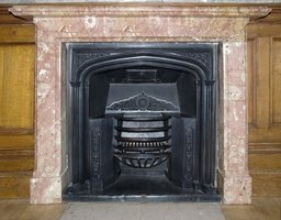 Cover a marble fireplace surround with sealer to protect it.