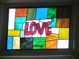 A stained glass look can be created using wax paper and crayons.