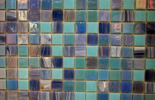 Seal the grout around glass tiles to keep the installation looking new.