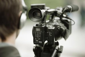 Close-up of man operating professional video camera.