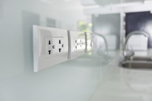 U.S. electrical outlets on kitchen wall.