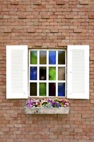 Mount flower boxes under windows to open up new decorating options.