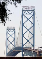 A passport is accepted as ID to cross the Ambassador Bridge.