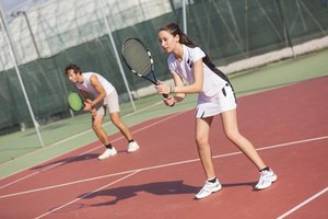 Young couple playing doubles tennis