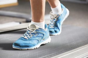 Woman's feet running on a treadmill.