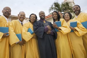 A pastor and choir standing in robes.
