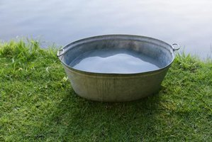 Make a fountain from a tin tub for country charm.