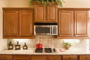A cabinet can help protect and secure a venting microwave.
