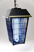 An outdoor bug zapper will work just as well indoors.