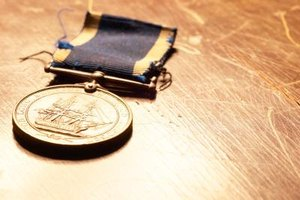 Close-up of navy medal on wooden table